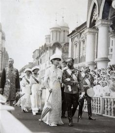 Photo from the tercentenary celebrations in 1913. Alexandra and Nicholas are walking up front, and you can see Alexei between their shoulders being carried in the procession. Behind them you can see Tatiana and Maria.