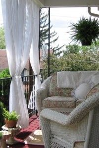 Ideas for the Balcony.  Love the curtains and the soft wicker funiture