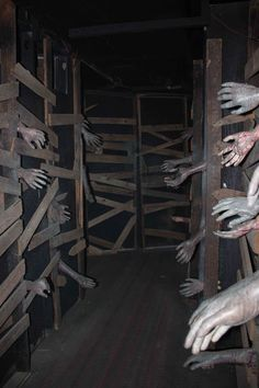 great idea for haunted house. the real trick is to have a false wall that someone stands behind, reaching an arm through. Grab at (dont touch!( guests as they pass through.