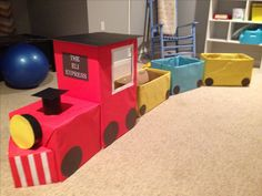 DIY train for train first birthday party. We used cardboard boxes and covered them with board paper.
