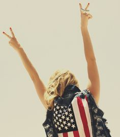 American Flag on Denim Vest, Eagle Ring; USA Pride and peace signs.
