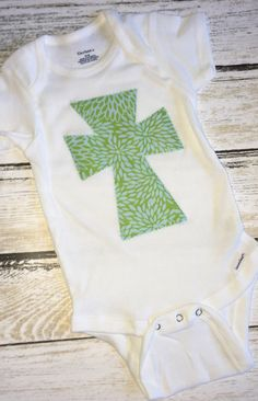 A personal favorite from my Etsy shop https://www.etsy.com/listing/476045147/cross-tee-girls-shirt-girls-monogram