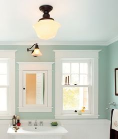 This bathroom is wonderful. I really want the schoolhouse light fixtures from rejuvenation. I love the idea of wainscoting, but I dont want bead-board. The medicine cabinet is perfect and the wall color is beautiful. Seafoam Bathroom, Bathroom Colors, Bathroom Layout, Bathroom Styling, Bathroom Lighting, Reno, Deco Design, Beautiful Bathrooms, Bathroom Inspiration