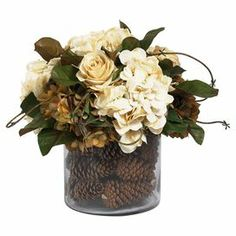 """Bring rustic style to your tablescape or mantel with this lovely arrangement, brimming with faux hydrangeas and pine cones.  FAUX FLORAL & PINE CONE ARRANGEMENT $140.95 Material: Glass and art silkColor: MultiDimensions: 14"""" H x 14"""" Diameter"""