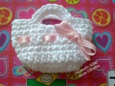 Piccole borsa ad uncinetto per bomboniere nascita o battesimo! - Guardalo