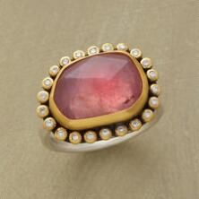 Like a view into a blushing nebula, this pink cosmos ring contains multitudes of beauty.
