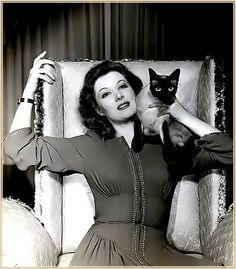 Greer Garson and Siamese cat