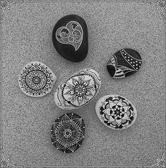 Such pretty and intricate black and white designs painted on stone!