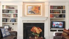 Bookcase Built In Bookshelves Around Fireplace | View photos of our custom built-in projects