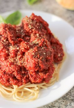 Thick and chunky marinara sauce loaded up with Italian spices and served over easy homemade meatballs and pasta.