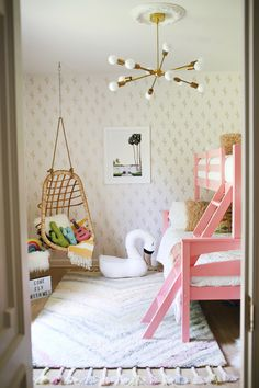 Flamingo inspired kids bedroom. Love the pink bunk beds and the basket chair.