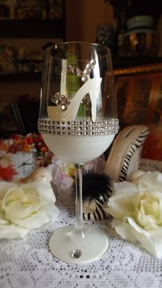 high heel shoe 20 oz wine glass with rhinestones. I also take custom request for personalized shoes and decorations on the glass.