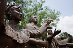 Statues built as a tribute to Juneteenth for the Texas Capitol grounds sit weathering at the Deep In The Heart of Texas Art Foundry property.