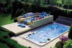 Swim-Spa Hydropool 14fx def need to get one like this :) LOVE the sliding pool cover that works as a sitting area :)