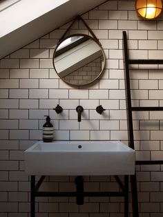 Bathroom (House F) - white metro tiles - bespoke basin stand - aged brass round mirror with demister - matt brass wall light