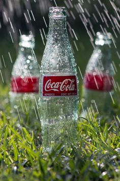 """Rain on Coke Bottles - Experimenting with slow shutter speed to """"drag"""" rain drops."""