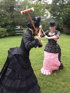 These ladies are having a croquet confrontation! <<THIS IS MY FAVORITE PICTURE ON THE INTERNET
