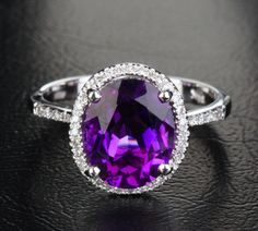 """Admired by brides, halo diamond engagement rings really are a signature type of Ritani. Halo rings have a central round stone encircled with a """"halo"""" of smaller sized diamonds or gemstones. Purple Engagement Rings, Halo Engagement, Purple Amethyst, Halo Diamond, Wedding Ring Bands, Beautiful Rings, White Gold, Amethyst Rings, Dark Purple"""