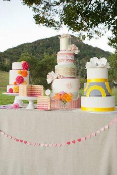 Pretty ruffled ribbon on center cake.