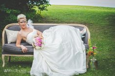 Bride on a couch outside.