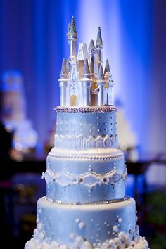 Towering in all its regal glory, this romantic confection will leave your guests breathless...and a little hungry!