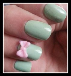 Minty #mani with a pink bow accent nail. Feels so Spring!