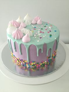A rainbow cake is fun to look at and eat and a lot easier to make than you might think. Here's a step-by-step guide for how to make a rainbow birthday cake. Bolo Drip Cake, Bolo Cake, Girly Cakes, Fancy Cakes, Pretty Cakes, Cute Cakes, Cake Cookies, Cupcake Cakes, Drippy Cakes