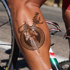 man with ouroboros knight tattoo