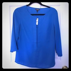 Express Front Slit Blue Blouse Gorgeous blue blouse; front slit with layer underneath. Cropped sleeves. I'm a soon-to-be mama looking to make space in her home and a little cash to provide for the new bundle of joy. No trades, please. Thanks for taking a look! Express Tops Blouses