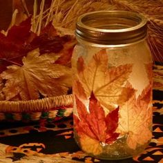 autumn crafts leaf jar     I enjoyed the warm glow of the candlelight dancing through the leaves so much that I just had to make a bigger one!  I used a large, one quart  jar with a two piece canning lid.  During it's life as a candle, I am using only the ring portion of the lid.
