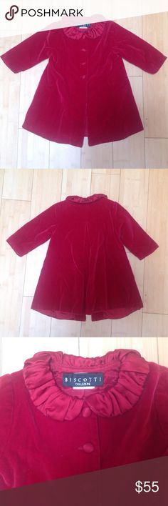 Biscotti Collection Red Velvet Coat - 12 Months Red velvet with satin ruffle collar, long sleeves, 4 buttons down the front, lined, two pleats in the back. Size 12 months. No care instruction label but I believe dry clean based on the fabric. Excellent condition, no tears, stains, no missing buttons Biscotti Jackets & Coats