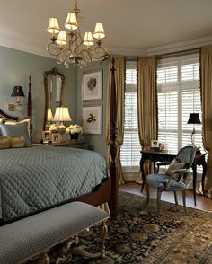 gold and blue. love the chandelier, the wall sconces, the mirror behind the lamp, the rug, the bench