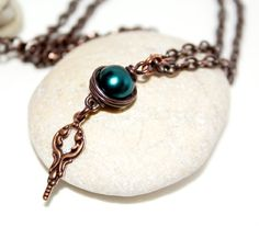 My own creation. Pure oxidized copper and glass bead.