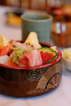 Chirashi-zushi (sushi) - A bowl of sushi rice topped with a variety of raw fish and garnishes.
