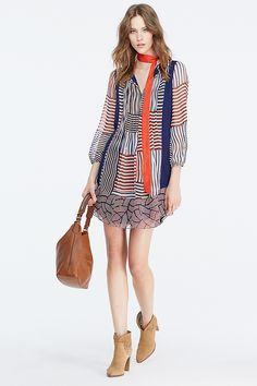 This chiffon tunic dress is perfect for the summer heat, while richly-hued prints bring it into the fall with tights and a mid-heel bootie. With front keyhole neckline that can be worn open or closed.