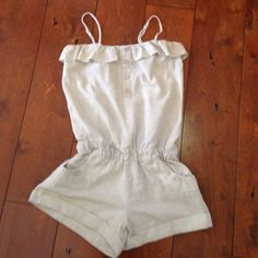 Linen Romper.  Festival play suit. Linen shorts Linen-cotton blend romper.  Elastic top and waist. Ruffle top. Adjustable spaghetti strap.  Cuffed shorts.  Super cute, super comfy, super lightweight.  Minimal pilling from wash. Good condition.  Label-Rhapsody. Pants Jumpsuits & Rompers