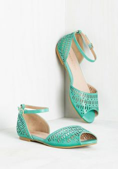 Why is it that each time you buckle into these turquoise flats by Restricted, the most merry times follow? The answer is arguable - some may say it's the square and rectangular cutouts of this vegan faux-leather pair that inspires the fun, while others insist it's the peep toes. Either way, enjoy!