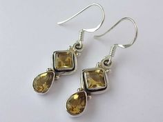 Unique design sterling silver earrings with sunny citrine cut stone and fine details throughout.