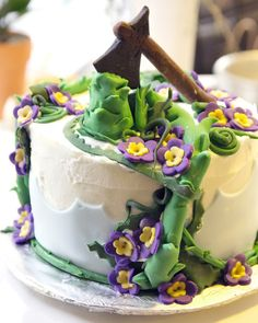 Jack and The Beanstalk cake. For a twisted fairytale party I'd skip the flowers & use a darker color to ice the cake & deeper tone for the vines.