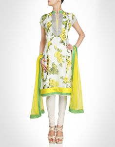 Yellow floral print on the georgette white suit. Shop Now: www.kimaya.in