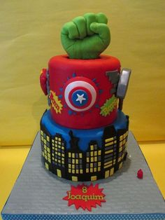 Super Heroes - Carrot cake, covered in chocolate ganache and decorated with fondant.
