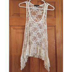 Flowy Shirt Sheer floral shirt. Loose and flowy. Can be worn with a bralette or over a bathing suit. Perfect summer accessory. Worn twice. Size large however fits like a small. Anything I buy is a small. Off white. Green envelope Tops Tank Tops