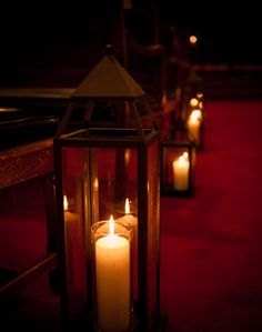 The red carpet and candles scream Broadway to me!  Pretty aisle decor?