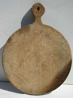 """324: 19thC PA maple 14"""" round breadboard w lollipop han : Lot 324"""