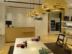Nak Bally | Shoes store design | Golden Hall | iidsk | Interior Design & Construction Golden Hall, Shoe Store Design, Interior Design And Construction, Retail, Architecture, Table, Furniture, Shoes, Color