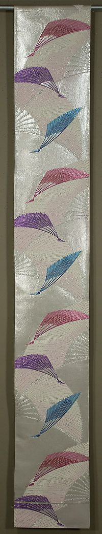 "Japanese Fukuro Obi  1950s.  12""x 165""  Decorated section:  12""x 103½.""  Silver lamé, with rose, lavender, turquoise, pink, and silver metallic brocading"