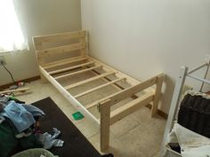 Gabe is outgrowing the crib I might just make him a new bed. DIY Toddler Bed. For under $30.