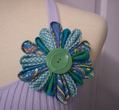 Fabric Kanzashi Flower Brooch. I love the combination of fabrics.
