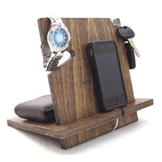 ***Looking for our personalized version of this docking station? Please click here*** This docking station is compatible with all cell phones (with or without cases) including all iPhone models and An