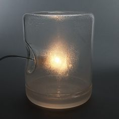 Dramprom by Roger Arquer Spanish designer Roger Arquer has created a lamp that uses condensation to diffuse light from the bulb.